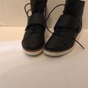 Black low platform sneakers by Simply Vera (Wang).